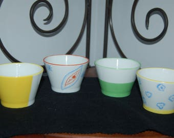 Small porcelain cups decorated by hand
