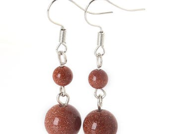 Beautiful red sand gold earring pair