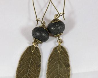 beautiful earrings of larva volcano stone and bronze metal