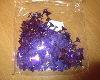 bag of brand new purple cocktail glass