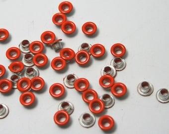Orange set of 40 eyelets