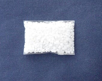 5 oz of small white flat crystals 3 mm