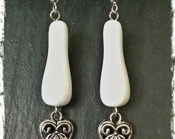 Silver heart and white dangle earrings