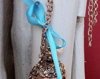 Long bow and bird cage necklace