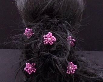 A purple flower hair pins