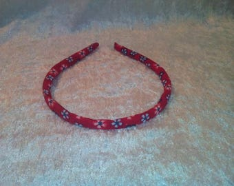 Red headband with flower motifs