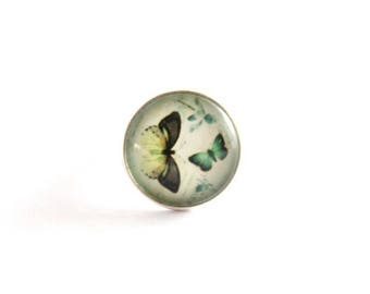 Adjustable ring with two Butterfly cabochon.