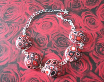 Bracelet with red, black and white mosaic of polymer clay cabochons