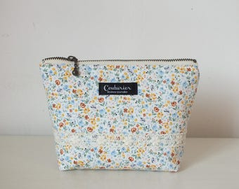 Small multicolored flower patterned makeup case