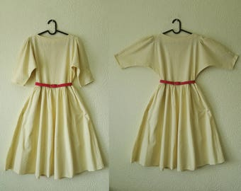 Sweet 1950s style yellow swing dress with bat sleeves - vintage - pastel yellow - textured cotton - puffed sleeves -bat sleeves- size UK8-10