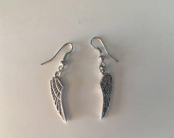 Earrings dangling wings