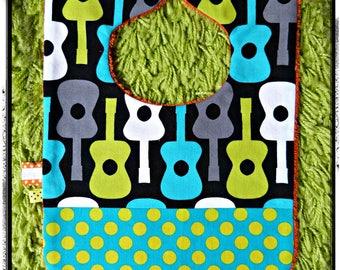 "Black bib and turquoise/polka dots lime ""guitars"" theme"