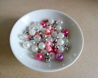 Assortment of beads - pink, white, silver mix - creating jewelry