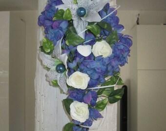 Bridal bouquet falling, cascading blue bouquet, artificial flowers.