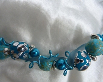 The Choker beads alumunium turquoise thread and rubber
