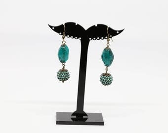 Dangling earrings with glass bead and spiral ball
