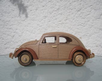 Decorative figurine of a VW Beetle in bois(hêtre/genévrier) car.