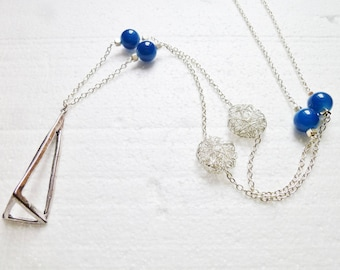 Necklace blue beads and triangular pendant