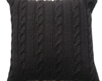 Black square cushion with cables hand knitted