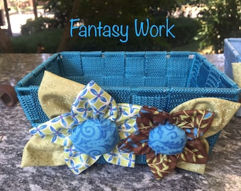 Blue basket with two fabric flowers