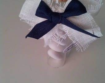 wedding favor beaker decorated with ribbons in fabric