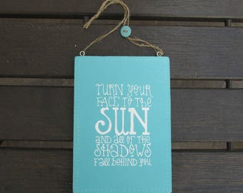 Turn your face to the sun and all of the shadows fall behind you - Handpainted Text Sign on wood - Home and wall decoration - Lightblue