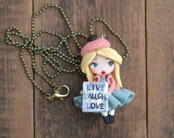Polymer clay doll with quote