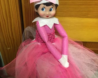 Pink elf on the shelf