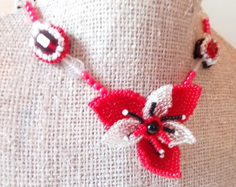 Red necklace, white, black, silver woven flower shape