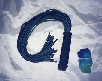 Teal and black thuddy flogger