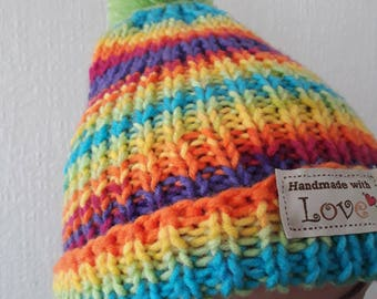 Rainbow knitted winter hat with pom pom