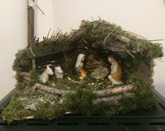 Christmas crib with Saints