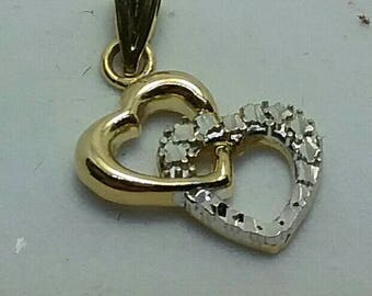 Solid 14k gold double heart  pendant.