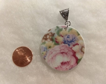 Lovely flowers on broken china pendant.  This piece is handmade from vintage china with soft pastel flowers.