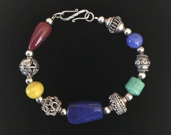 Handbeaded sterling silver beaded bracelet with mixed color glass beads