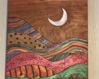 Whimsical pyrography metallic watercolor landscape on wood block