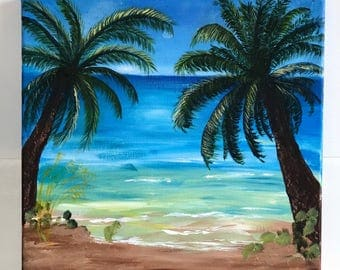 Beach scene with sand and palm trees