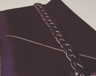 Leather clutch bag with plait