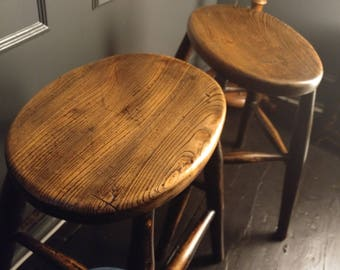 A pair of Elm stools with lovely aged patena