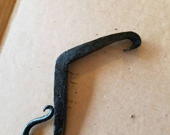 Hand forged one-handed bottle opener