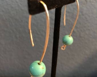 Silver dangle earings with turquoise colored bead