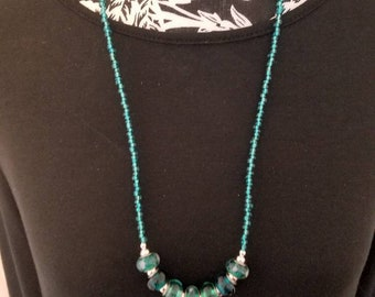 Emerald green glass beads with silver accent beads
