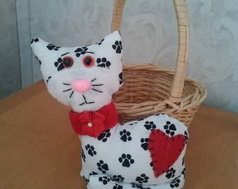 Cat in paw print novelty fabric. Safety eyes n nose. Velcro collar. Measures 5 inches high.