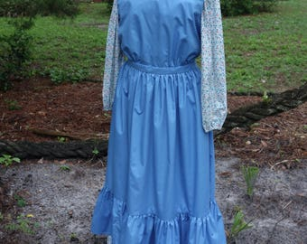 Ladies', size 12/14,  Pioneer/Prairie costume in multi floral calico print with blue pinafore.