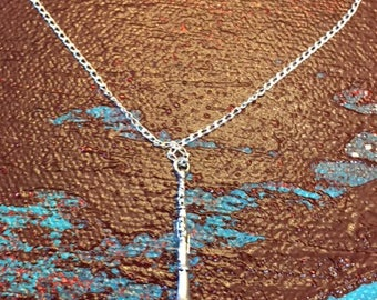 Clarinet necklace, see other possible charm necklaces.