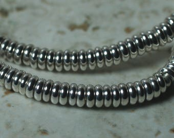 Silver tone rondelle beads aprox 4mm in diameter 1mm thick 2mm hole size, 12 pcs (item ID FA2465MB)