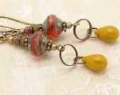 Perles de verre orange et jaune Style Boho soucoupe boucles d'oreilles avec rustique