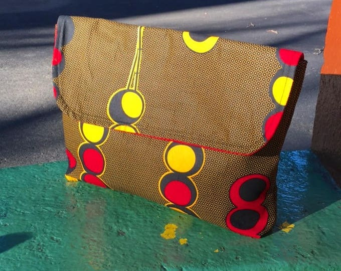 "Featured listing image: Brown and Gold African Wax Cloth 14"" Envelope Clutch Purse, Travel Case, Cotton Portfolio Bag"