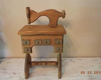 Vintage wooden treadle sewing machine with small storage area decoration / sewing storage