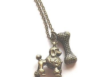 HALF PRICE SALE Poodle puppy and dog bone charm antique bronze necklace